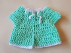 There are loads of little crochet baby jackets available but I couldn't find exactly what I was looking for.      I wanted instructions fo...