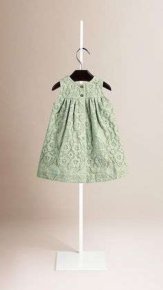 An A-line Burberry dress in floral lace, woven on traditional Leavers looms in England. Discover the childrenswear collection at Burberry.com