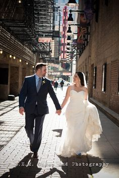 Beautiful walking shot of bride and groom. Chicago State Street. 2015 R.E.M. Weddings www.remvp.com
