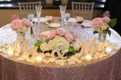 The two sat at a sequined sweetheart table behind Mr. and Mrs. signs.   Venue/Caterer: Providence Biltmore  Floral Designer: Golden Gate Studios  Rentals: Rentals Unlimited