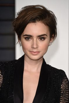 The pixie cut is as it fullest this season, with the hair longer in the front and to one side. It is still edgy, but we are drifting further away from the harsh side-shaved look into something more soft and feminine. It can be styled with texture and body, like how Lily Collins wears it, or more polished and straight. Chabbi Styling Tip: On dry hair, spray a medium hold hair spray. Then use either a medium curling iron to a few create waves or a flat iron if you want ...