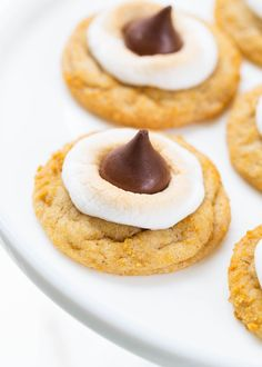 Soft and chewy s'mores cookies with a buttery graham cracker flavoreddough, a gooeymarshmallow and chocolate HERSHEY'S KISSon top! This summer treat is even better than the traditional s'mores and no campfire is needed! One of my favorite summer traditions is roasting marshmallows with the kids in the backyard. We make a fire at least once …
