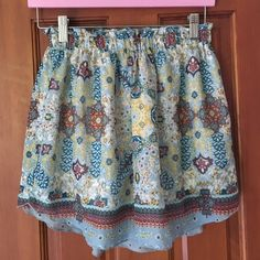 Printed flowy skirt Elastic waist band. Has a white slip WAYF Skirts Mini