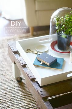 DIY pallet coffee table, would definitely sand it down and paint it Some funky bright color :)