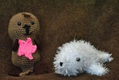 Here are a couple of cuties. Sea otter with star fish and a baby seal.
