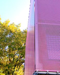 Attention grabbing pink painted architectural mesh facade. There are numerous options available for coloring stainless steel mesh.