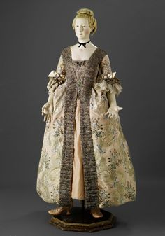 An Exceptionally Rare French 18th-Century Painted Wood Female Mannequin wearing a Robe à la française in silk metallic wrapped thread
