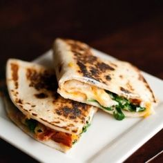 Cheesy Spinach and Bacon Quesadillas - A quick and easy dinner recipe Really good, the cheese mixture really makes it. I'm assuming they used small tortillas not the typical burrito size for quesadillas because I had to double the recipe at it only made Quick Easy Meals, Easy Dinner Recipes, Great Recipes, Favorite Recipes, Quesadilla Recipes, Yummy Quesadillas, Breakfast Quesadilla, I Love Food, Food Dinners