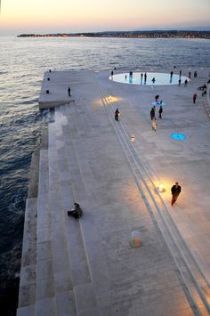 Sea organ and Sun salutation in Zadar designed by architect Nikola Basic. The organ sighs as the waves sweep through it. The sun salutation collects the suns rays by multilayered glass plates. Thanks to Croatia's climate it now powers the whole harbour front lighting system.