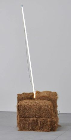 Mario Merz, Untitled, 1969, bales of hay and neon tube