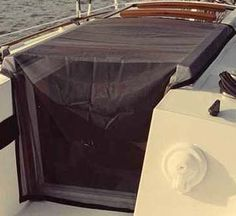 Custom fit bug screen for companionway. Let the breeze in, keep the bugs out!