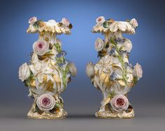 A highly ornamental pair of Old Paris porcelain vases crafted by Jacob Petit, celebrated ceramicist and one of the most significant producers of Rococo ornamental wares during the 1830s.