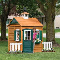 Big Backyard Bayberry Ready-to-Assemble Wooden Playhouse-would make a cute playhouse chicken coop once modified and made predator proof.  $199 @ Walmart.