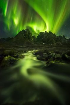 Peaks of the Lights by Marc Adamus| The Aurora display over jagged peaks in the Yukon photographed while snowshoe backpacking the Ogilvie Mountains
