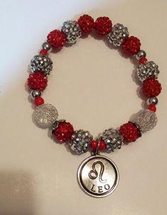 Red & silver horoscope bracelet.
