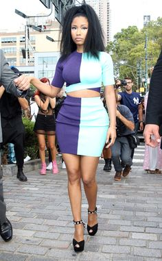 Nicki Minaj goes bold while attending Alexander Wang's show for New York Fashion Week.