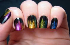 Sparkly Jagged Rainbow Gradient!  First layer your nails in black.  Next, using glitter polish and a nail art brush (Or an eyeliner brush, concealer brush - any thin brush will do) make thin vertical lines going down your nail.  Neatness does NOT count; you want uneven lines! Use at least 2 colors on each nail, creating a gradual gradient.  *Amp up the oomph* Use multichrome polish instead of glitter polish! *Tone it down* Use a neutral base, and cream polish instead of glitter.