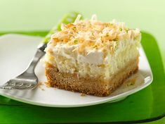 """Prize-Winning Recipe Pack a powerful punch of tropical flavors with a quick-mix layered bar. """"Lime in the Coconut"""" Frosted Cheesecake Bars Key Lime Cheesecake, Coconut Cheesecake, Cheesecake Desserts, Coconut Bars, Cheesecake Squares, Coconut Cream, Coconut Slice, Lemon Coconut, Caramel Cheesecake"""