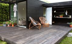 Floating deck with outside sink. Black cladding