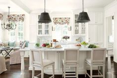Lightened-Up Kitchen: After - Before-and-After Kitchen Makeovers - Southernliving. Designer Suzanne Kaslerpainted everything a serene white, and replaced the cabinetry. With Design Galleria's Matthew Quinn, she conceptualized the floor-to-ceiling cabinets and a handsome island. Glass door fronts lighten the main wall. To add texture to her monochromatic color scheme, she installed white marble countertops, a white tile backsplash, and neutral barstools.