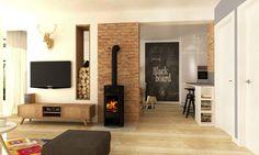 Czerwone cegły i czarny kominek w salonie