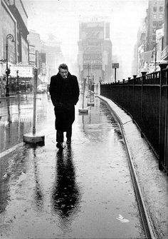 """James Dean in Times Square.  Adam Gopnik from The New Yorker wrote that Dean was """"bearing the weight of a generation on his shoulders.""""  Photo by Dennis Stock."""