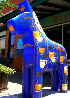 """The town is decorated with """"Wild Dala"""" horses, painted in bright colors. They also have a Dala Festival, which is a sight to see if you're looking for a treat. Lindsborg Ks, Lindsborg Kansas, I Love Coffee, Coffee Talk, Coffee Break, About Sweden, The Swede, Scandinavian Folk Art, Most Beautiful Animals"""