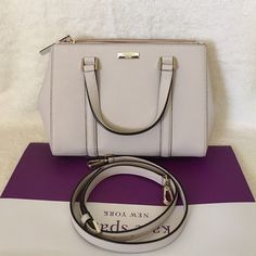 """⚜Kate Spade⚜Newbury Lane Loden Small ✨Brand New With Tag and Bag, Guarantee Authentic✨Also available in Black and pink•pls check out my closet if interested  ONLY $165 ON VIINTED!!!  Size: Small•color: pebble Details: Satchel with snap closure and an adjustable, removable strap Dual interior slide pockets, two zipper, compartments, and interior zipper pocket Gold Kate Spade New York signature 8.2x10.9x4.7  drop length 4.3"""" handle  14 karat light gold hardware kate spade Bags Satchels"""