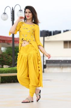 The gown features a beautiful embroidered work around it which enhances the look of the outfit. Salwar Designs, Kurti Designs Party Wear, Blouse Designs, Indian Gowns, Indian Attire, Pakistani Dresses, Indian Outfits, Punjabi Salwar Suits, Indian Salwar Kameez