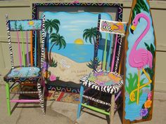 For the beachy cabin....Sunset window, flamingo ironing board, flip flop chair, fishy chair!