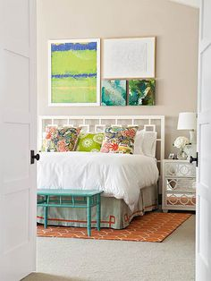 bedroom--rug on carpet, simple bench, white headboard
