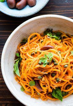Sweet Potato Spaghetti made with spiralized sweet potatoes in zesty tomato sauce. This easy Italian Sweet Potato Spaghetti bowls recipe is paleo, & vegan!