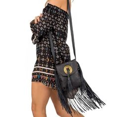 NWT Cleobella Bandit Crossbody NEVER BEEN USED. NWT. The Bandit is for our rock n'roll bellas who love swaying to their favorite festival sounds. Fringe trim and a western Concho look perfect paired with a vintage tee and heaps of turquoise rings. Lined, with an interior pocket.  Leather crossbody bag Fringe accents Adjustable strap Buckle centerpiece Measurements: 8.5in width, 10in height Cleobella Bags Crossbody Bags