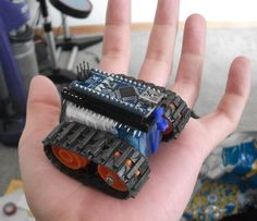 PaulMakesThings has a pretty cool instructable on how to build a tiny Arduino Nano based robot. This robot uses two modified servo. Arduino Uno, Arduino Programming, Linux, Arduino Board, Python Programming, Projets Raspberry Pi, Robotics Projects, Iot Projects, Diy Robot