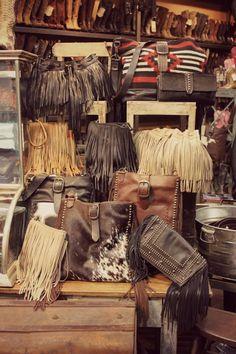Fringe, fringe and more fringe! | McFadin Fringe Bags at Boot Star... OMG, I wish that was my closet!!!!