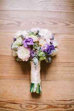 purple and ivory bouquet, photo by J.Bird Photography http://ruffledblog.com/austin-le-san-michele-wedding #weddingbouquet #flowers