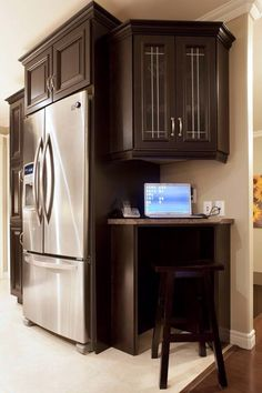 Kitchen nook great use of the empty space by the fridge!
