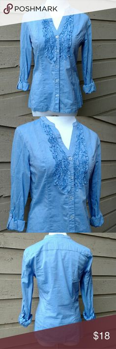 NWOT H&M Button Down Blouse NWOT H&M button down v-neck ruffled roll sleeve blue blouse size 6. Great condition, never worn.  V-neck with ruffles. Five working front buttons. Buttons on the sleeve allowing for a rolled up or down look. Comes with extra buttons attached to care tag. Nice structural lines. 16 inch bust. 17 inch sleeve rolled up. 23 inch sleeve rolled down 23 inch length.  100% cotton. H&M Tops Button Down Shirts