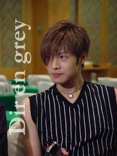 Toshiya. Dir en Grey. He looks like Light from Death Note with this hairstyle.