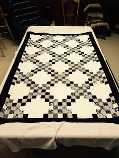 Double Irish Chain.  Black and White.  This is twin size but designed for use on a couch.  There is a grey line in this too.    The black lines used a Black and White jelly roll.  That's pattern has a French theme.