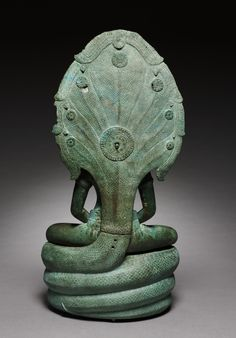 Naga-Enthroned Buddha, 1100s  Cambodia, Angkor, Angkor Wat Period, 12th century  bronze, Overall: 58.4 x 28 cm (22 15/16 x 11 in).