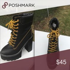 Women's Lace-up Boots Black boots with yellow & black shoe laces. Shoes are gently used, but are in great condition. Shoes Heeled Boots
