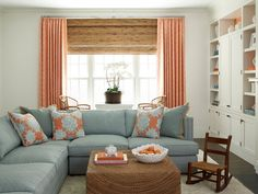 Coastal living room in pale turquoise, coral and natural.