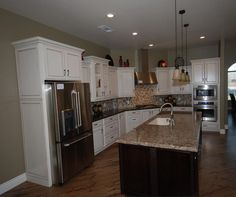 St. Jude 2012 Dreamhome kitchen with KraftMaid Vanilla Bean and Peppercorn cabinets.
