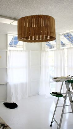 Can you believe this was a rather simple DIY lamp shade made w/ paint stirring sticks?! Brilliant