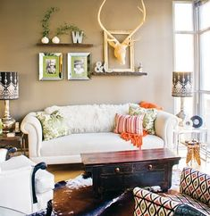 My antler obcession! love the shelves, colors, patterns, everything!