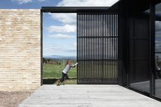 A large, steel sliding screen allows the northern deck to be used in a variety of weather conditions.
