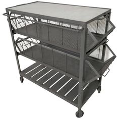 Metal trolly on wheels featuring two large mesh sided drawers, lower storage platform and a marble insert on top. Heavy iron, solid construction. Makes a great kitchen island.