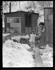 Home of family of a Utah coal miner in Consumers, near Price, Utah 1936 in the snow during the Great Depression. Description from pinterest.com. I searched for this on bing.com/images
