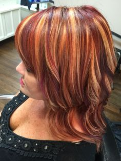 Red hair. Copper and plum highlights. Hair By Cameron Amthor @ Lift Salon in Georgetown Texas.
